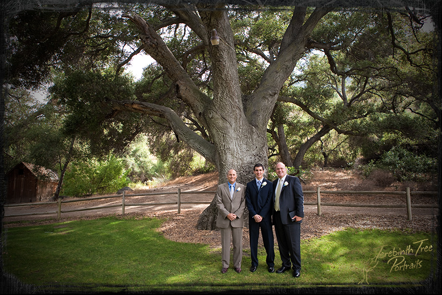 Wedding photo of Daniel, his father and his father-in-law under a large oak tree at the Temecula Creek Inn
