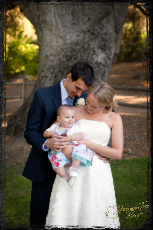 Brooke, Daniel and Amanda in front of an oak tree at their wedding at the Temecula Creek Inn