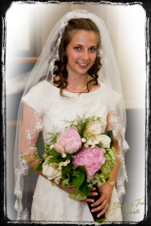 Photo of Chelsea the bride and her bouquet on her wedding day at out church in Temecula
