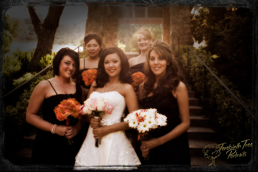 Wedding photo of Megan and her bridesmaids standing on the big stairs at the Pala Mesa Resort in Fallbrook