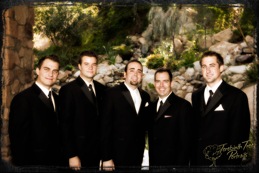 Wedding photo of Matt and his groomsmen standing in front of a waterfall at the Pala Mesa Resort in Fallbrook