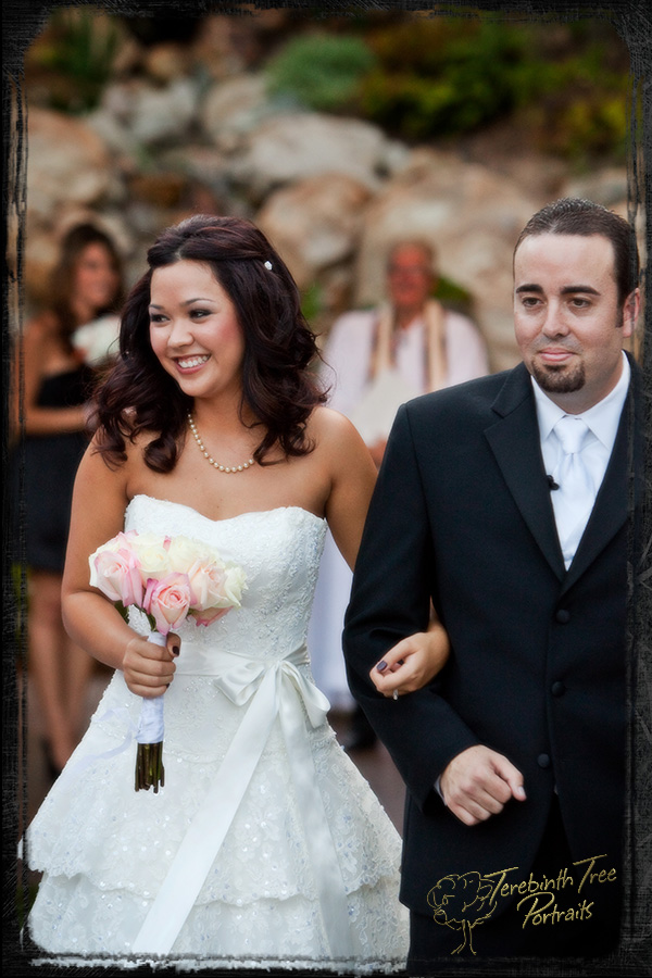 Photo of Megan and Matt walking down the aisle at their Fallbrook wedding
