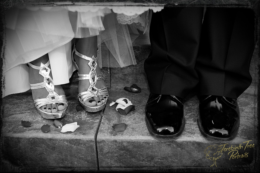Closeup photo of Megan and Matt's shoes taken at their Fallbrook wedding